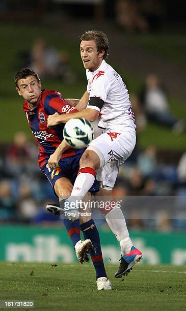 Michael Bridges of Newcastle Jets contests the ball with Matt Thompson of Melbourne Heart during the round 21 ALeague match between the Newcastle...