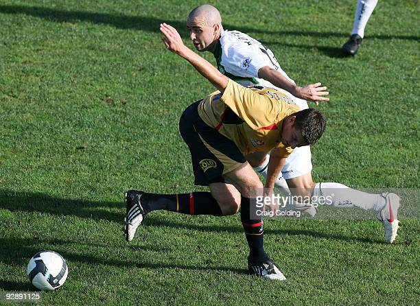 Michael Bridges of the Jets and James Robinson of the Fury compete for the ball during the round 14 match between the Newcastle Jets and the North...