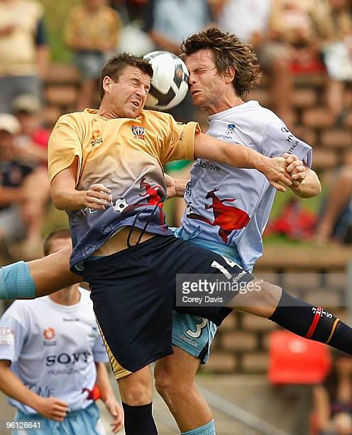 Michael Bridges of the Jets and Stephan Keller of Sydney contest the ball during the round 24 ALeague match between the Newcastle Jets and Sydney FC...