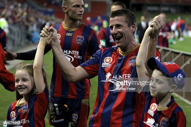 Michael Bridges of the Jets celebrates the win and last game with his children during the round 27 ALeague match between the Newcastle Jets and...