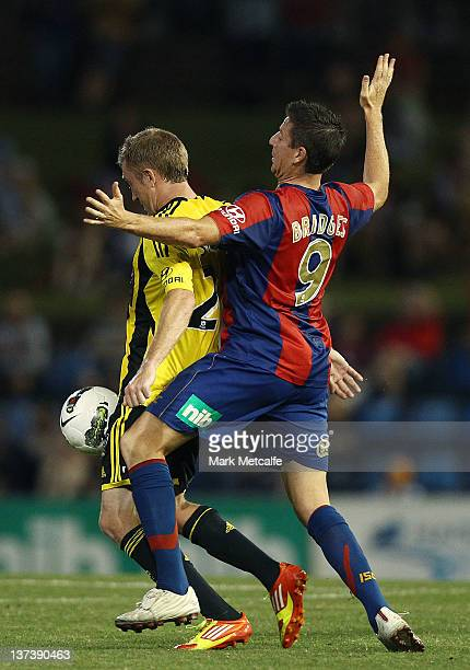 Michael Bridges of the Jets challenges Alexander Smith of the Phoenix during the round 16 ALeague match between the Newcastle Jets and the Wellington...