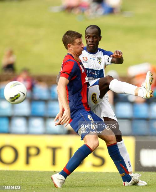 Michael Bridges of the Jets competes with Jonas Salley of United during the round 13 midweek ALeague match between Newcastle United and Gold Coast...