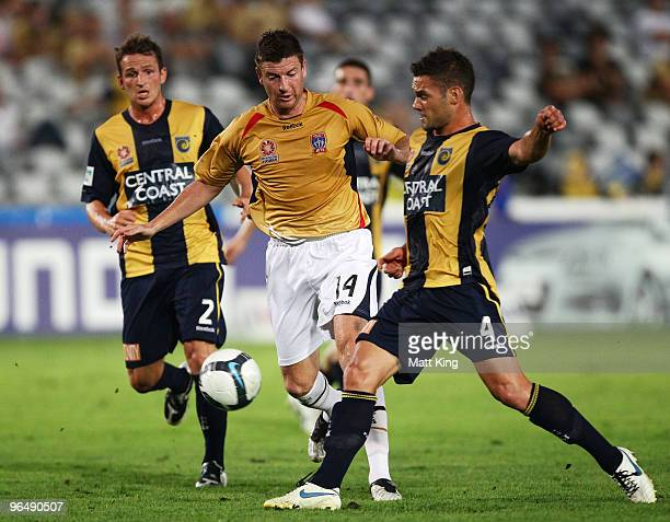 Michael Bridges of the Jets is challenged by Pedj Bojic of the Mariners during the round 26 ALeague match between the Central Coast Mariners and the...