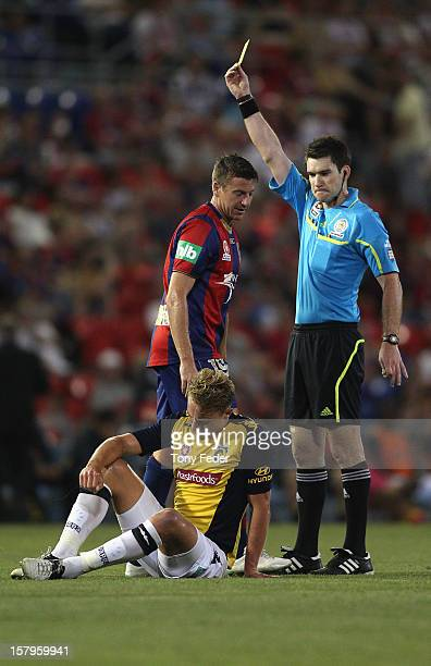 Michael Bridges of the Jets is shown a yellow card during the round ten ALeague match between the Newcastle Jets and the Central Coast Mariners at...
