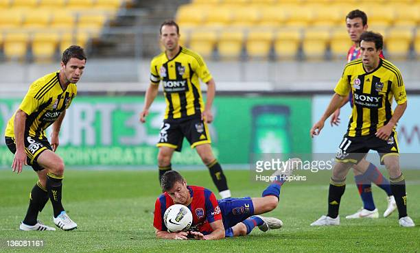 Michael Bridges of the Jets loses his footing during the round 12 ALeague match between Wellington Phoenix and Newcastle Jets at Westpac Stadium on...