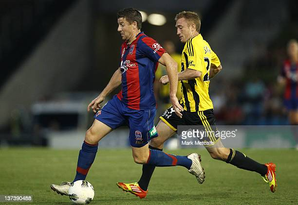 Michael Bridges of the Jets runs away from Alexander Smith of the Phoenix during the round 16 ALeague match between the Newcastle Jets and the...