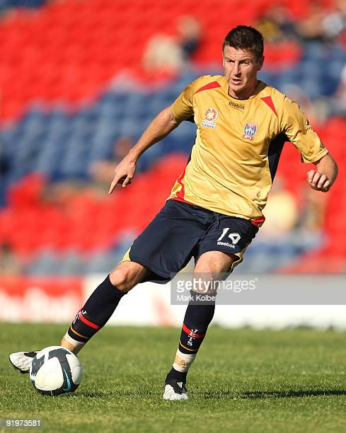 Michael Bridges of the Jets runs with the ball during the round 11 ALeague match between the Newcastle Jets and the Melbourne Victory at...