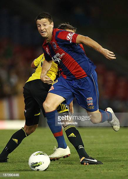 Michael Bridges of the Jets runs with the ball during the round 16 ALeague match between the Newcastle Jets and the Wellington Phoenix at Ausgrid...