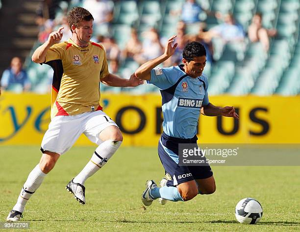 Michael Bridges of the Jets tackles Simon Colosimo of Sydney FC during the round 16 ALeague match between Sydney FC and the Newcastle Jets at Sydney...