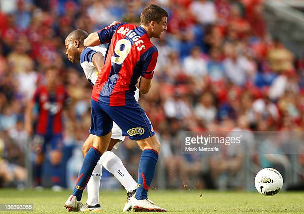 Michael Bridges of the Jets takes on Maceo Rigters of United during the round 13 midweek ALeague match between Newcastle United and Gold Coast United...