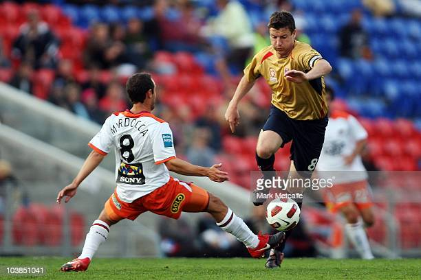 Michael Bridges of the Jets takes on Massimo Murdocca of the Roar during the round five ALeague match between the Newcastle Jets and the Brisbane...