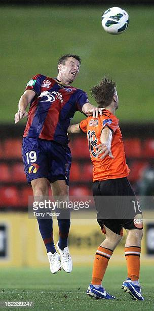 Michael Bridges of the Newcastle Jets contests the header against Luke Brattan of the Brisbane Roar during the round 22 ALeague match between the...