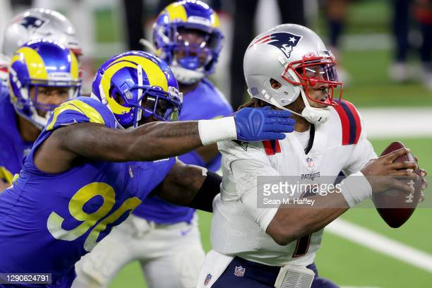 Michael Brockers of the Los Angeles Rams sacks Cam Newton of the New England Patriots during the third quarter in the game at SoFi Stadium on...