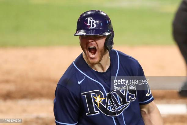 Michael Brosseau of the Tampa Bay Rays celebrates after hitting a solo home run against the New York Yankees during the eighth inning in Game Five of...