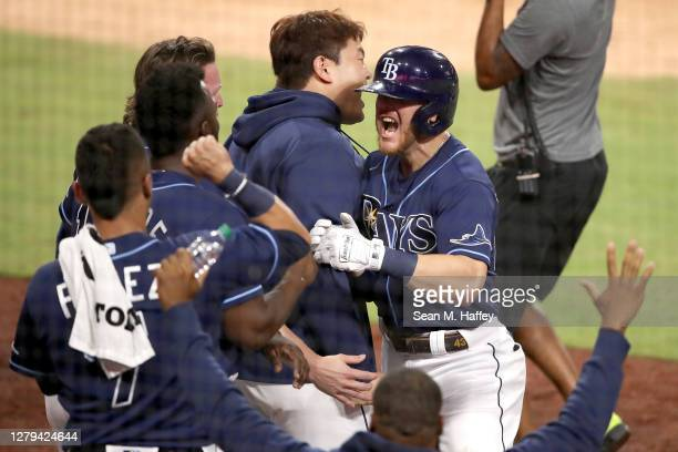 Michael Brosseau of the Tampa Bay Rays celebrates with teammates after hitting a solo home run against the New York Yankees during the eighth inning...