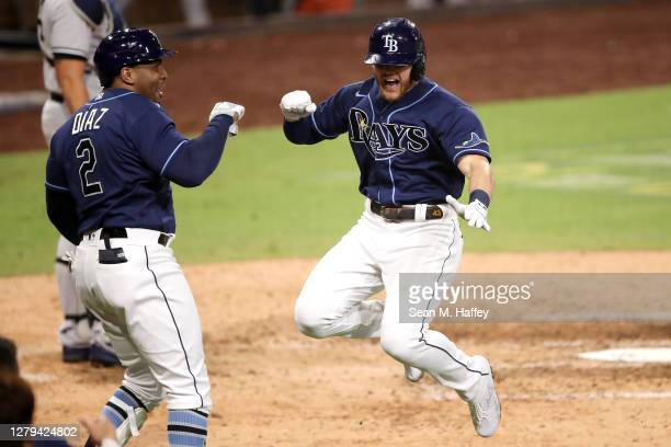 Michael Brosseau of the Tampa Bay Rays celebrates with Yandy Diaz after hitting a solo home run against the New York Yankees during the eighth inning...