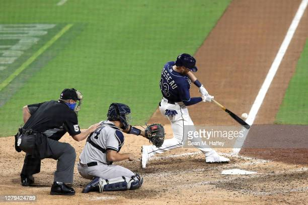 Michael Brosseau of the Tampa Bay Rays hits a solo home run against the New York Yankees during the eighth inning in Game Five of the American League...