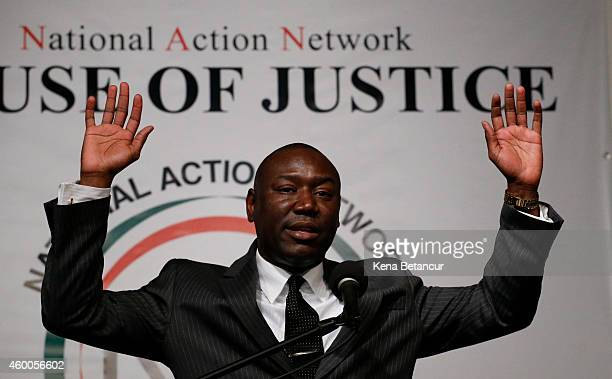 Michael Brown and Trayvon Martin's family attorney Benjamin Crump does the HandsUp Don't Shoot action during a rally at National Action Network in...
