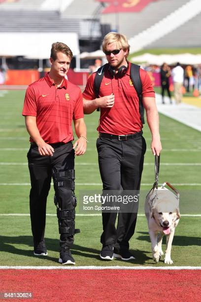 Michael Brown and USC Jake Olson with his guide dog Quebec before a college football game between the Texas Longhorns and the USC Trojans on...