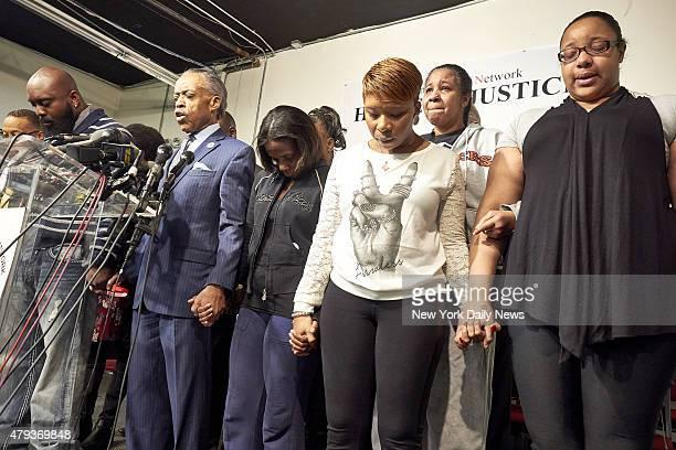 Michael Brown father of shooting victim Michael Brown Rev Al Sharpton Kimberly Michelle Ballinger domestic partner of shooting victim Akai Gurley and...