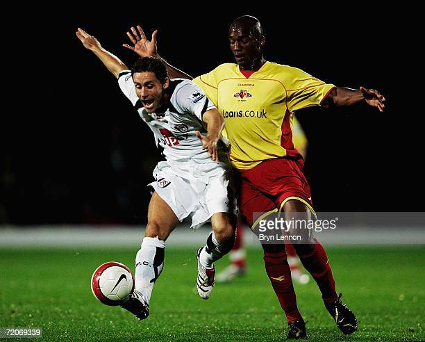 Michael Brown of Fulham is challenged by Damien Francis of Watford during the Barclays Premiership match between Watford and Fulham at Vicarage Road...