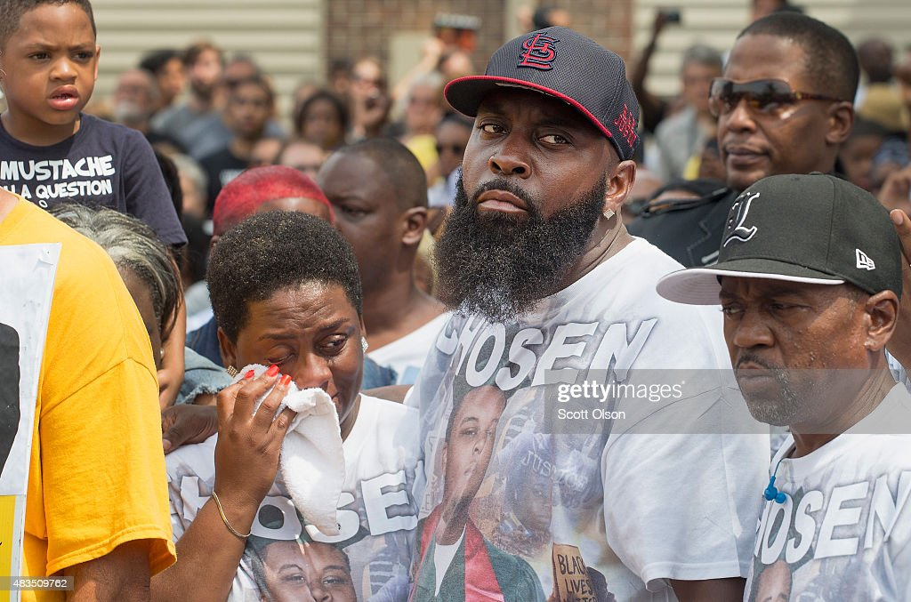 Michael Brown Sr Comforts His Wife Cal Brown During A Moment Of