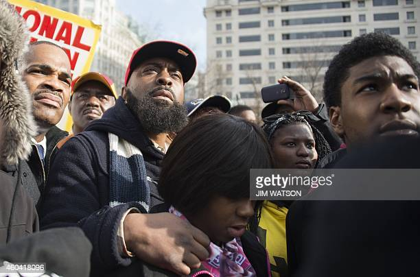 Michael Brown Sr the father of Ferguson shooting victim Michael Brown stands with others during the Justice For All march in Washington DC December...