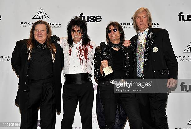 Michael Bruce Alice Cooper Dennis Dunaway and Neal Smith of Alice Cooper Band pose in the press room at the 26th annual Rock and Roll Hall of Fame...