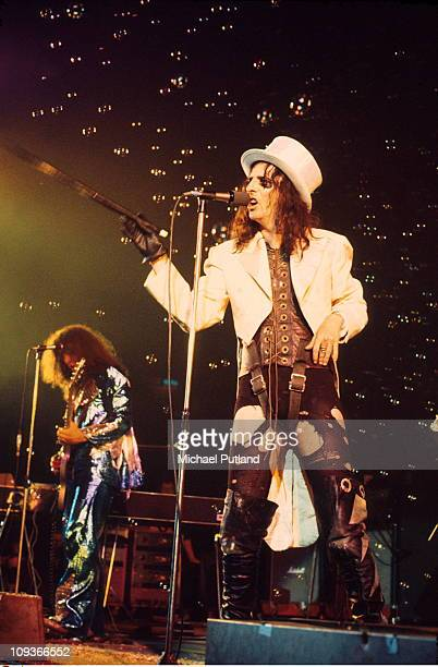 Michael Bruce and Alice Cooper perform on stage London 1975