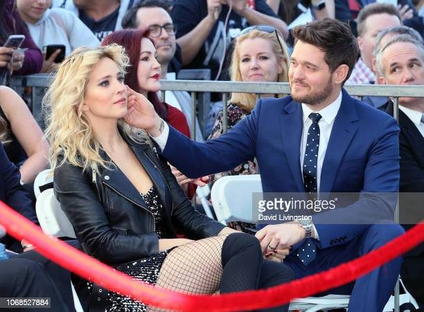 Michael Buble and wife Luisana Lopilato attend his being honored with a Star on the Hollywood Walk of Fame on November 16 2018 in Hollywood California