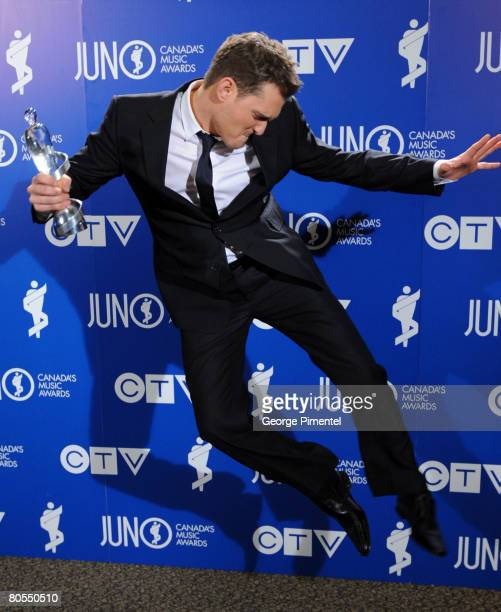 Michael Buble poses with his award at the 2008 Juno Awards April 6 2008 at the Pengrowth Saddledome in Calgary Canada