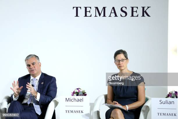 Michael Buchanan head of strategy and senior managing director of portfolio strategy and risk group at Temasek Holdings Pte left speaks as Sulian Tay...