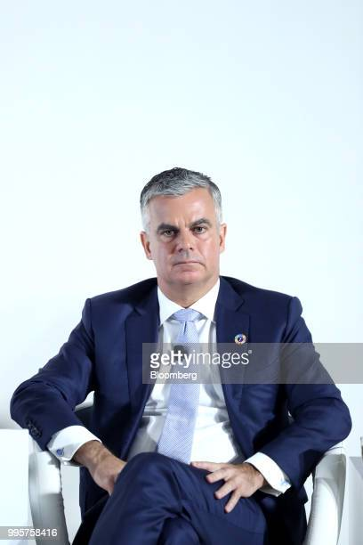 Michael Buchanan head of strategy and senior managing director of portfolio strategy and risk group at Temasek Holdings Pte speaks during a news...