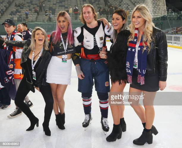 Michael Budd of the USA poses with fans during the Ice Hockey Classic match between the United States of America and Canada at Hisense Arena on June...