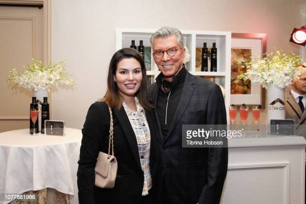 Michael Buffer and Christine Prado attend HBO LUXURY LOUNGE Presented By Obliphica Professional Day 2 on January 5 2019 in Beverly Hills California