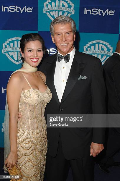Michael Buffer and Christine Prado during InStyle & Warner Bros. 2006 Golden Globes After Party - Arrivals at Beverly Hilton in Beverly Hills,...