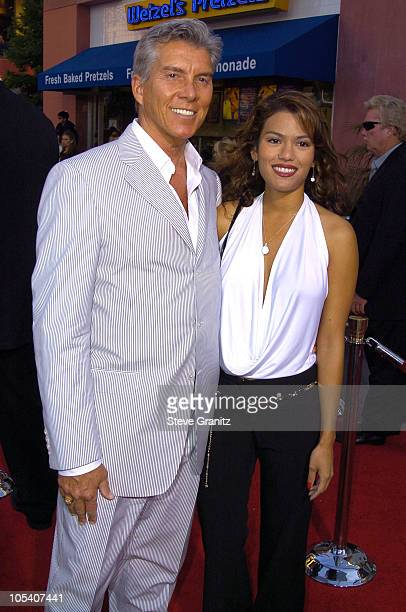 Michael Buffer and Christine Prado during The Chronicles Of Riddick World Premiere Arrivals at Universal Amphitheatre in Universal City California...