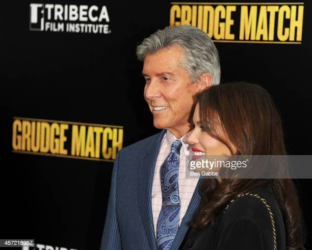 Michael Buffer and wife Christine Prado attend the Grudge Match screening benefiting the Tribeca Film Insititute at Ziegfeld Theater on December 16...