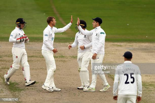 Michael Burgess of Sussex Sharks celebrates with bowler and team mate Danny Briggs after catching Dominic Sibley of Warwicksire during the Specsavers...