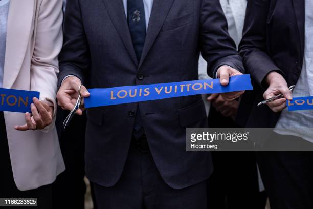 Michael Burke chief executive officer of Louis Vuitton cuts a ceremonial ribbon as the luxury fashion label opens a new leather goods workshop in...