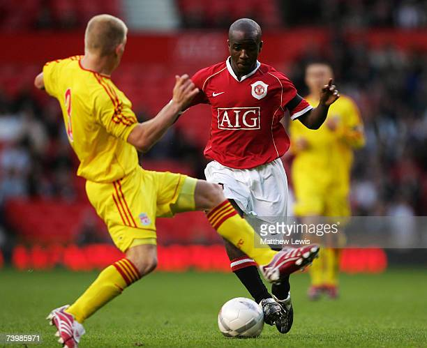 Michael Burns of Liverpool tackles Fabien Brandy of Manchester during the FA Youth Cup 2nd Leg match between Manchester United and Liverpool at Old...