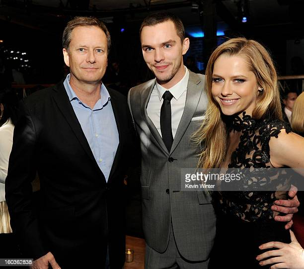 Michael Burns Vice Chairman Lionsgate actors Nicholas Hoult and Teresa Palmer pose at the after party for the premiere of Summit Entertainment's Warm...