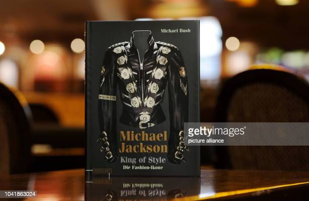 Michael Bush fashion designer of deceised singer Michael Jackson presents his new book at the Hard Rock Cafe in Munich Germany 29 April 2013 Bush...