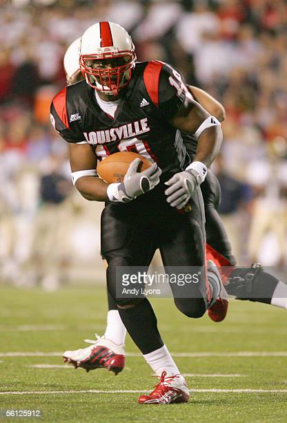Michael Bush of the Louisville Cardinals carries the ball during the game against the Pittsburgh Panthers at Papa John's Stadium on November 3 2005...