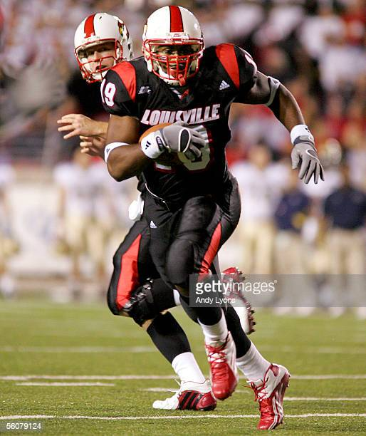 Michael Bush of the Louisville Cardinals runs with the ball against the Pittsburgh Panthers during the game on November 3 2005 at Papa John's Stadium...