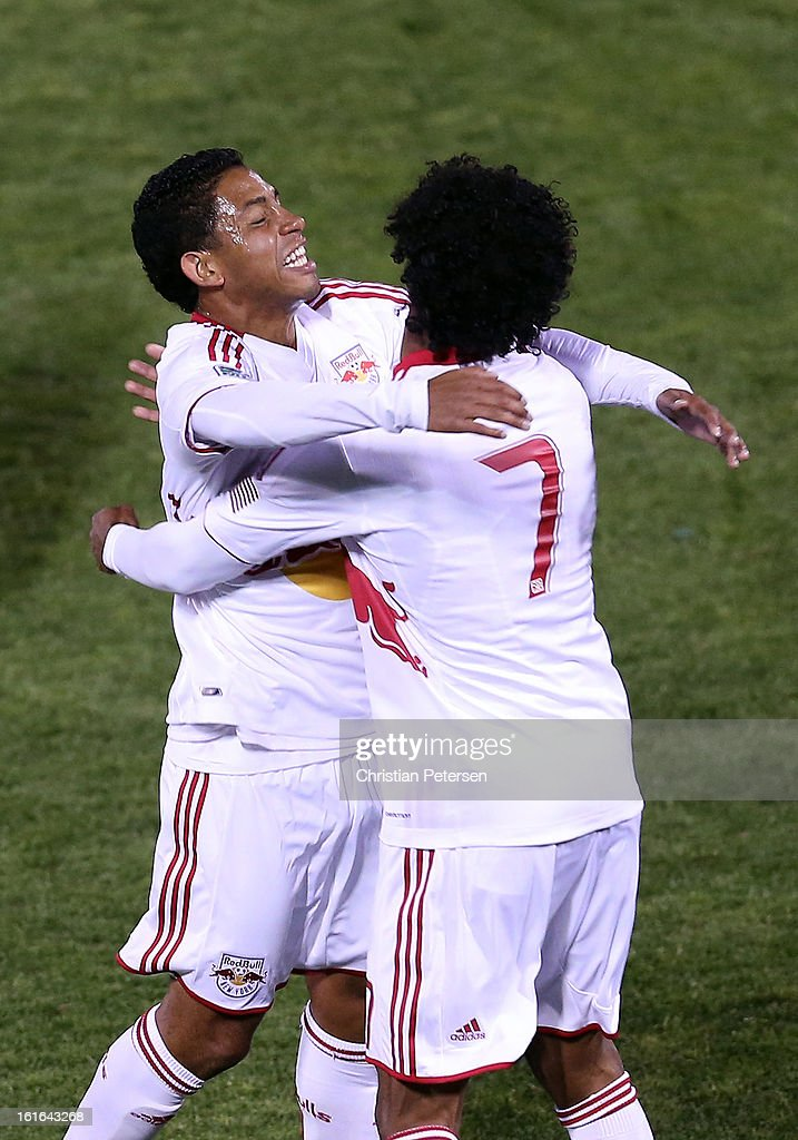 Michael Bustamante #20 of the New York Red Bulls celebrates with Roy Miller #7 after Bustamante scored a second half goal against Real Salt Lake during FC Tucson Desert Diamond Cup at Kino Sports Complex on February 13, 2013 in Tucson, Arizona.