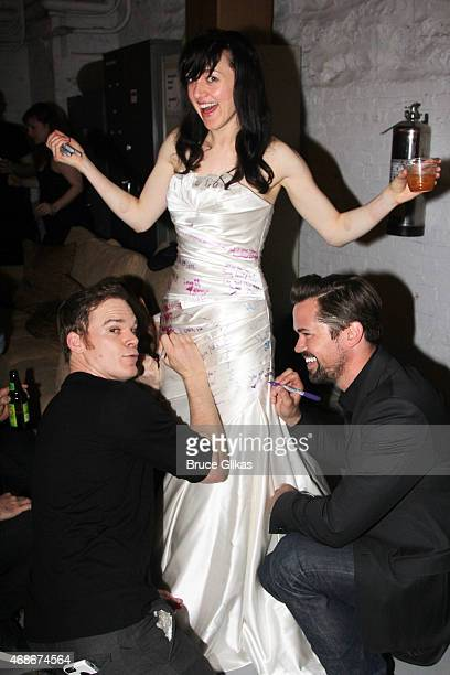Michael C Hall Lena Hall and Andrew Rannells pose while they sign Tony Winner Lena Hall's dress at her last performance celebration backstage at...