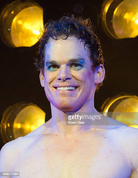 """Michael C. Hall performs on stage during the curtain call of """"Hedwig And The Angry Inch"""" at Belasco Theatre on October 29, 2014 in New York City."""