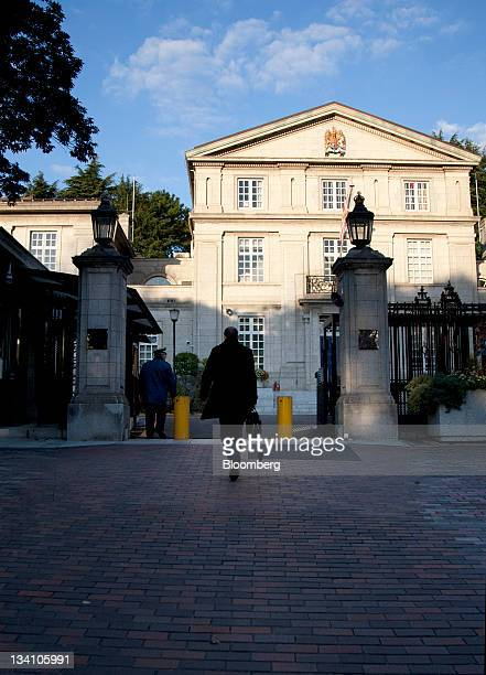 Michael C. Woodford, former president and chief executive officer of Olympus Corp., walks towards the British Embassy in Tokyo, Japan, on Saturday,...
