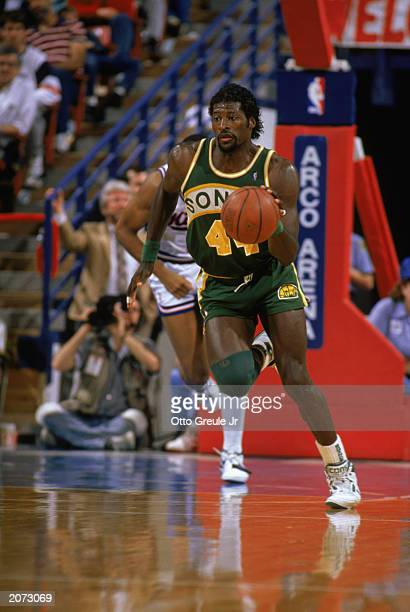 Michael Cage of the Seattle Supersonics drives the ball up court during a game against the Sacramento Kings in the 19881989 NBA season at Arco Arena...